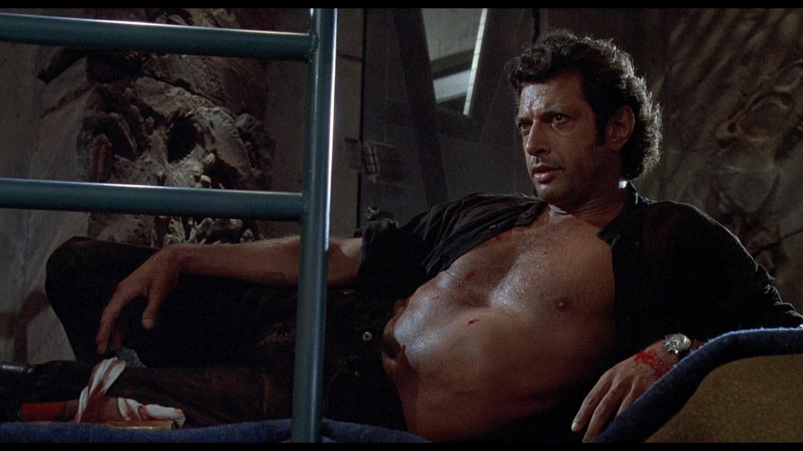 Jeff Goldblum as Dr. Ian Malcolm in Jurassic Park, shirtless and in a come-hither pose.